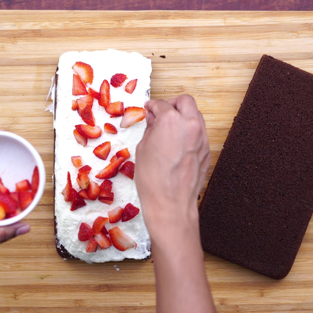 topping cake with strawberry