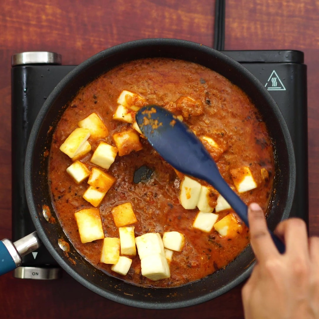 adding fried paneer and mixing