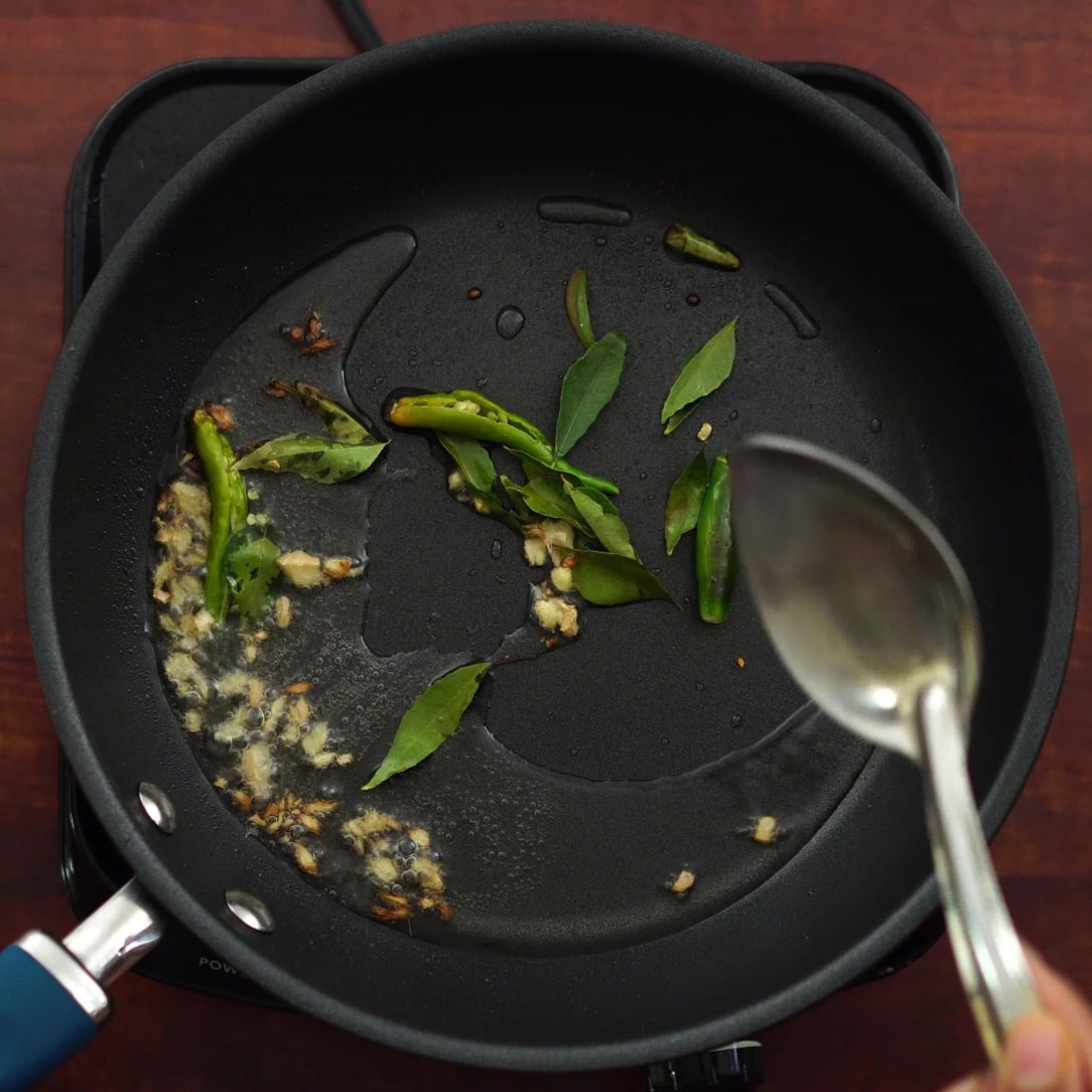 adding oil, chili etc in a hot pan