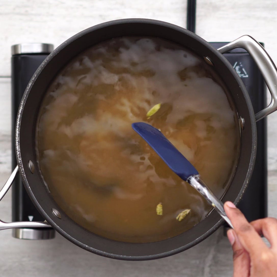 Mixing sugar in water for syrup