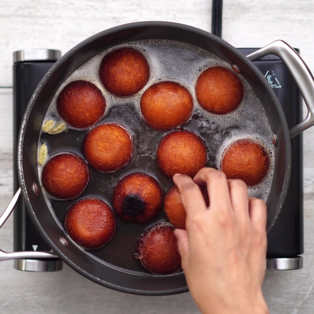 Fried Jamun is added into the syrup