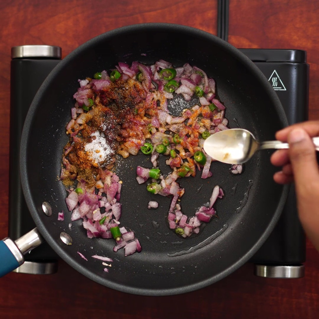 adding masala with onion