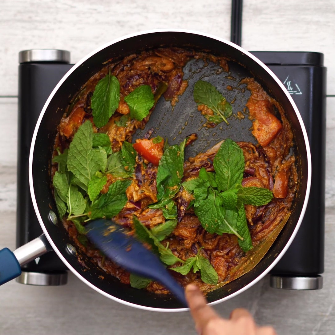 Adding curd, mint leaves and sauteing