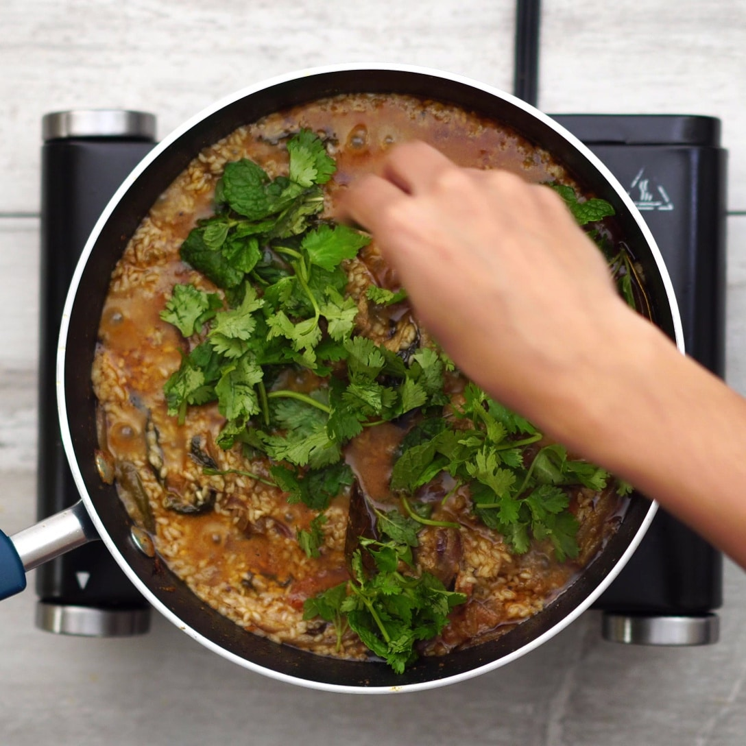 Adding coriander and mint leaves