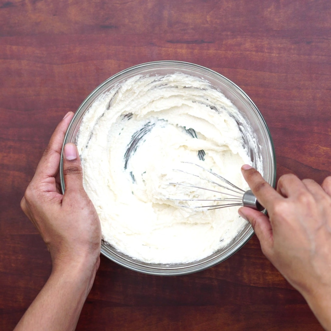 adding butter, sugar, cream and whisking