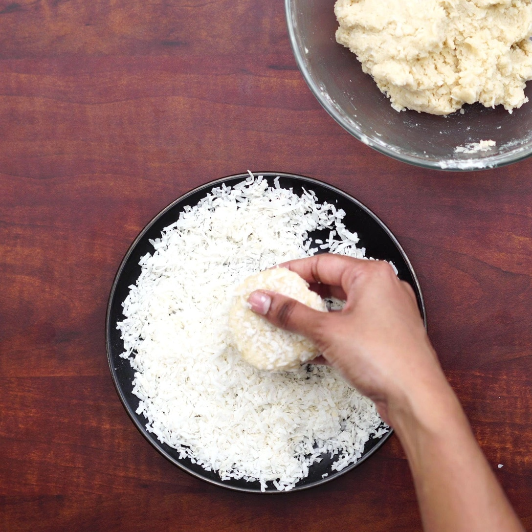 coating dough with coconut flakes