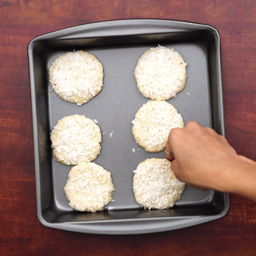 placing dough in a tray