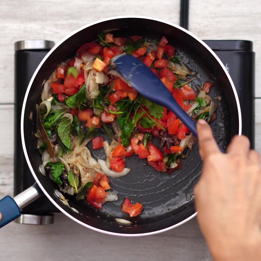 adding leaves and tomato
