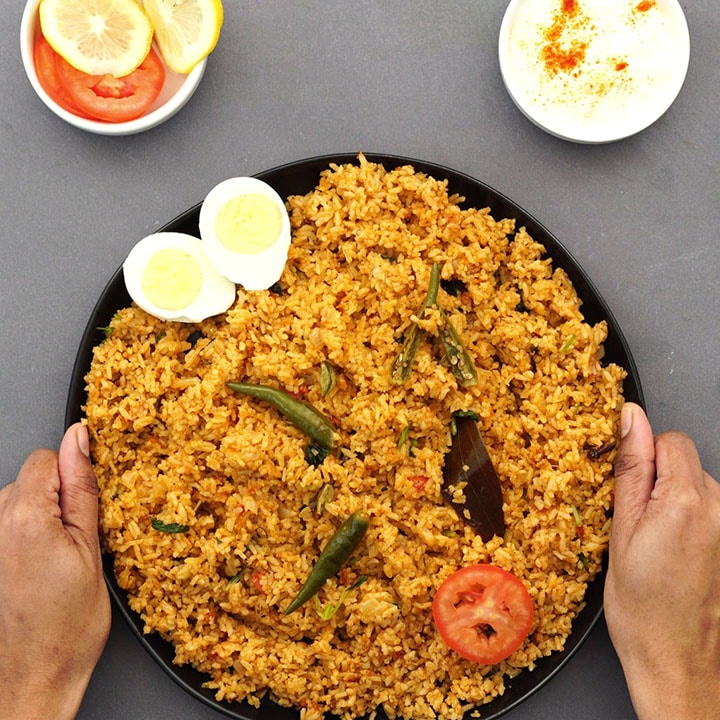 serving the plain biryani rice