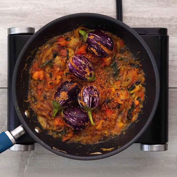 Adding stuffed brinjal into the mix