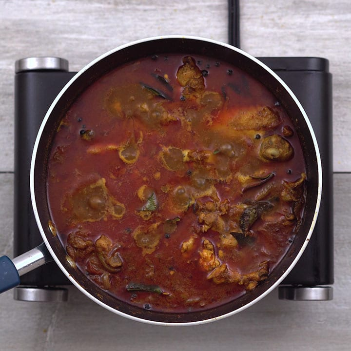Chicken gravy is garnished with curry leaves