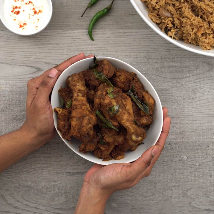 serving the spicy Andhra kodi/chicken/kozhi vepudu