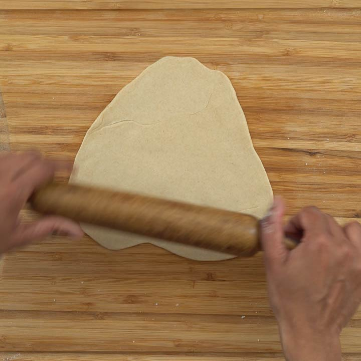 rolling the dough for chapati, triangle shape