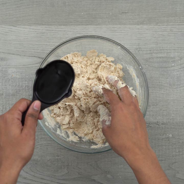 combing the dough and mixing water