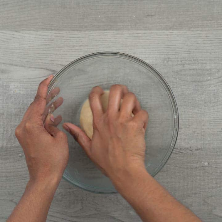 kneading again the dough for roti/chapathi