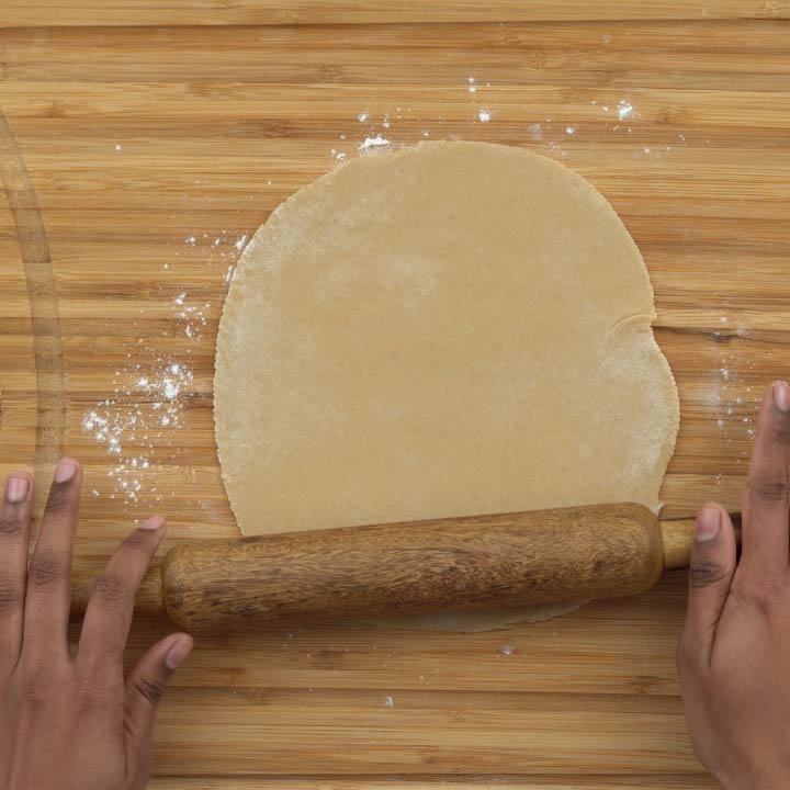 rolling the dough to circular shape