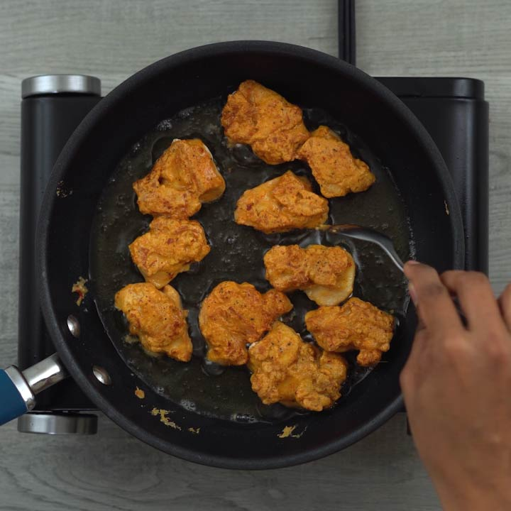 Fliping and frying the chicken pieces