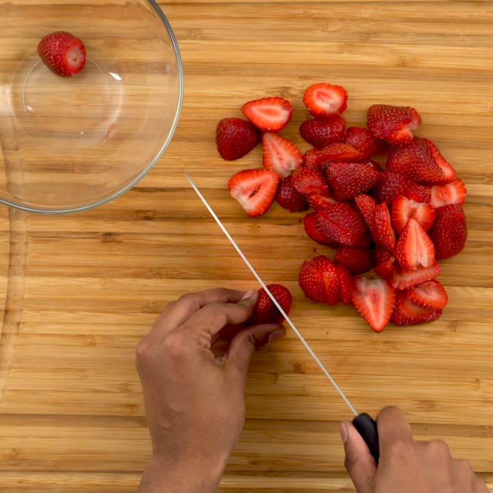 cutting strawberries into small pieces