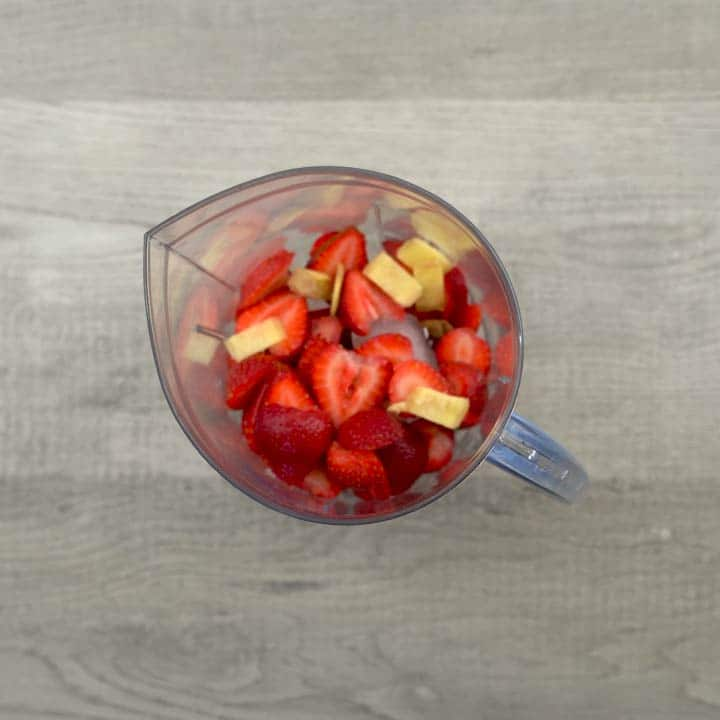 ingredients added for strawberry juice in blender