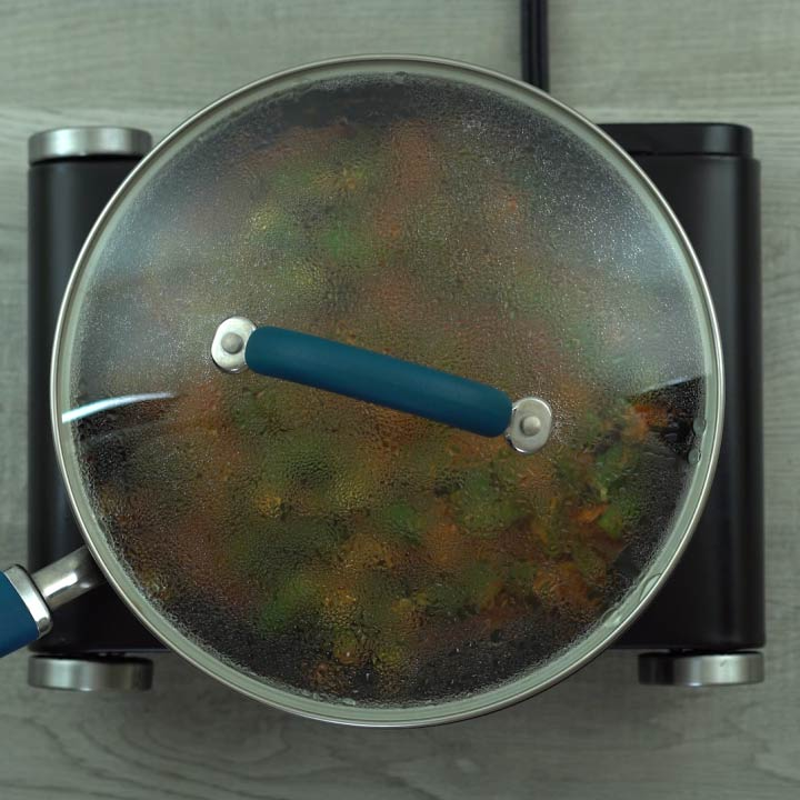 bhindi masala is cooking with lid closed