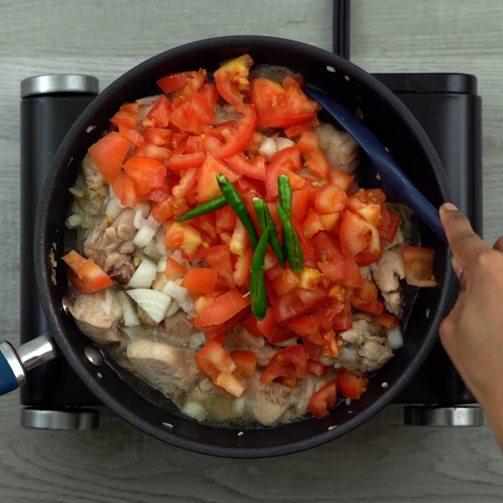 Onion, tomato and green chili is added