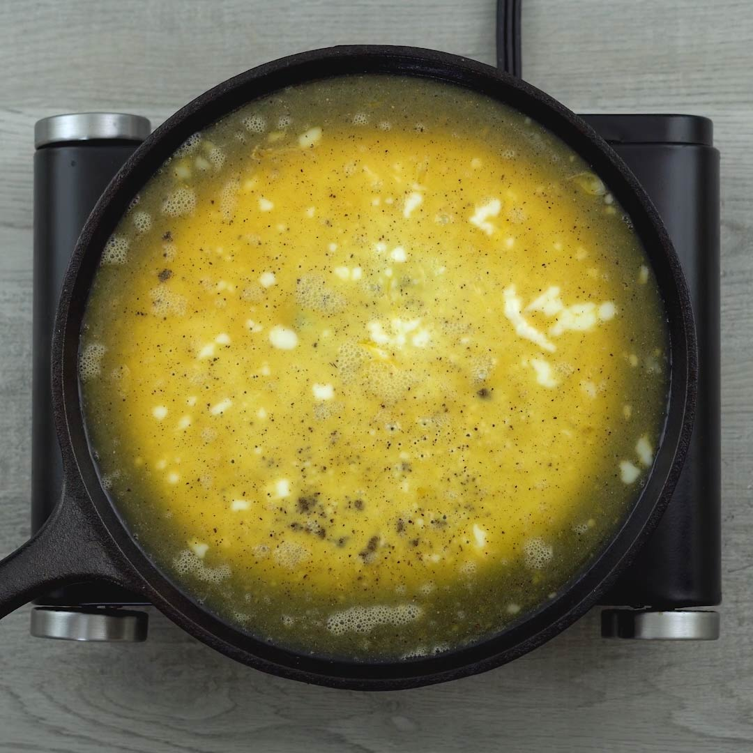 omelet cooking on a pan