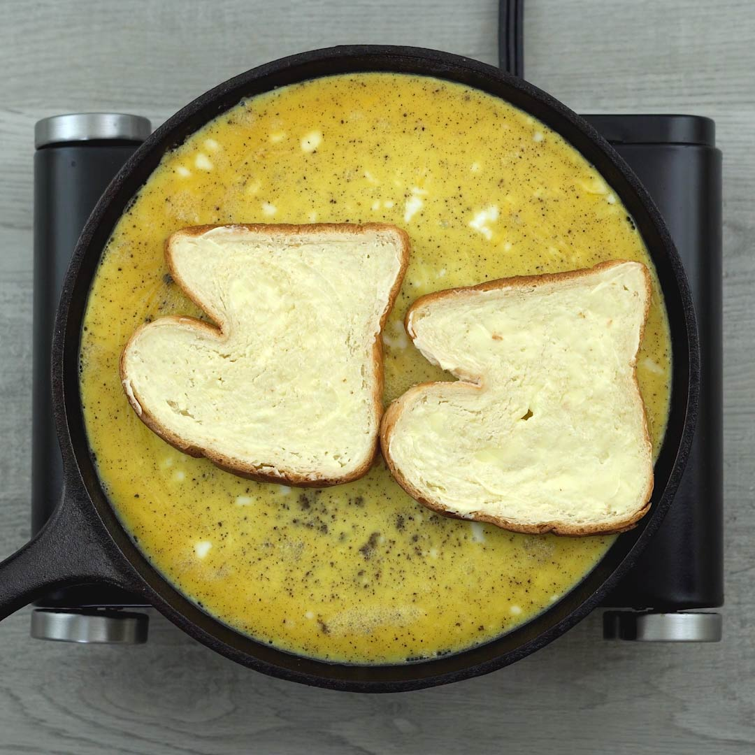 bread placed on the omelet