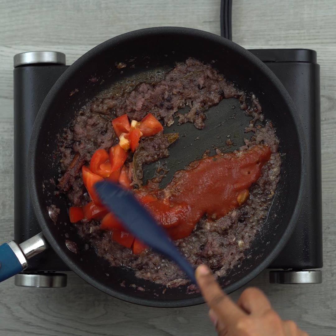 sauteing tomatoes and paste