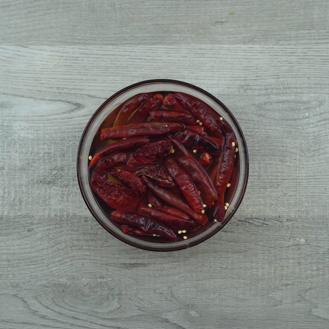 soaked red chilies in a bowl