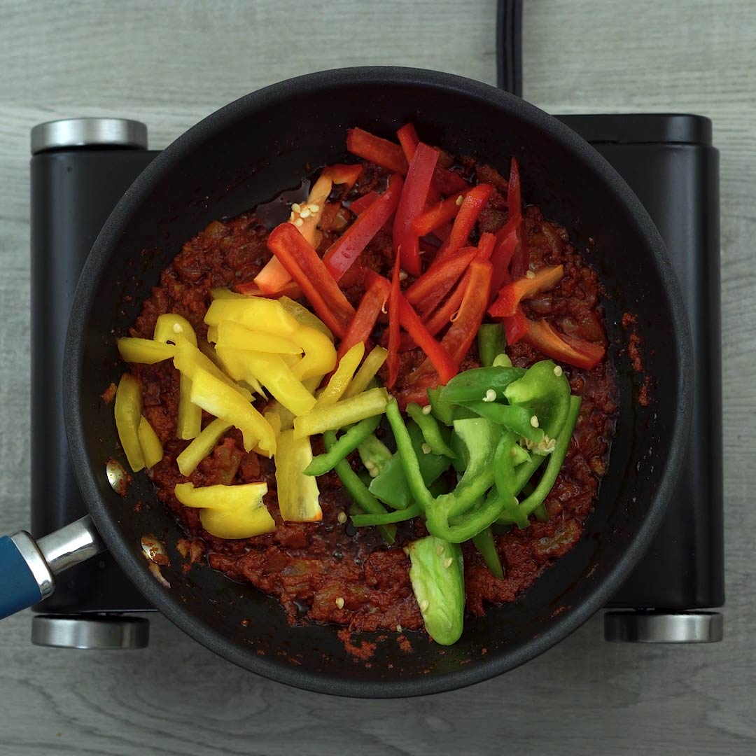 green, red and yellow bell peppers added to panang curry