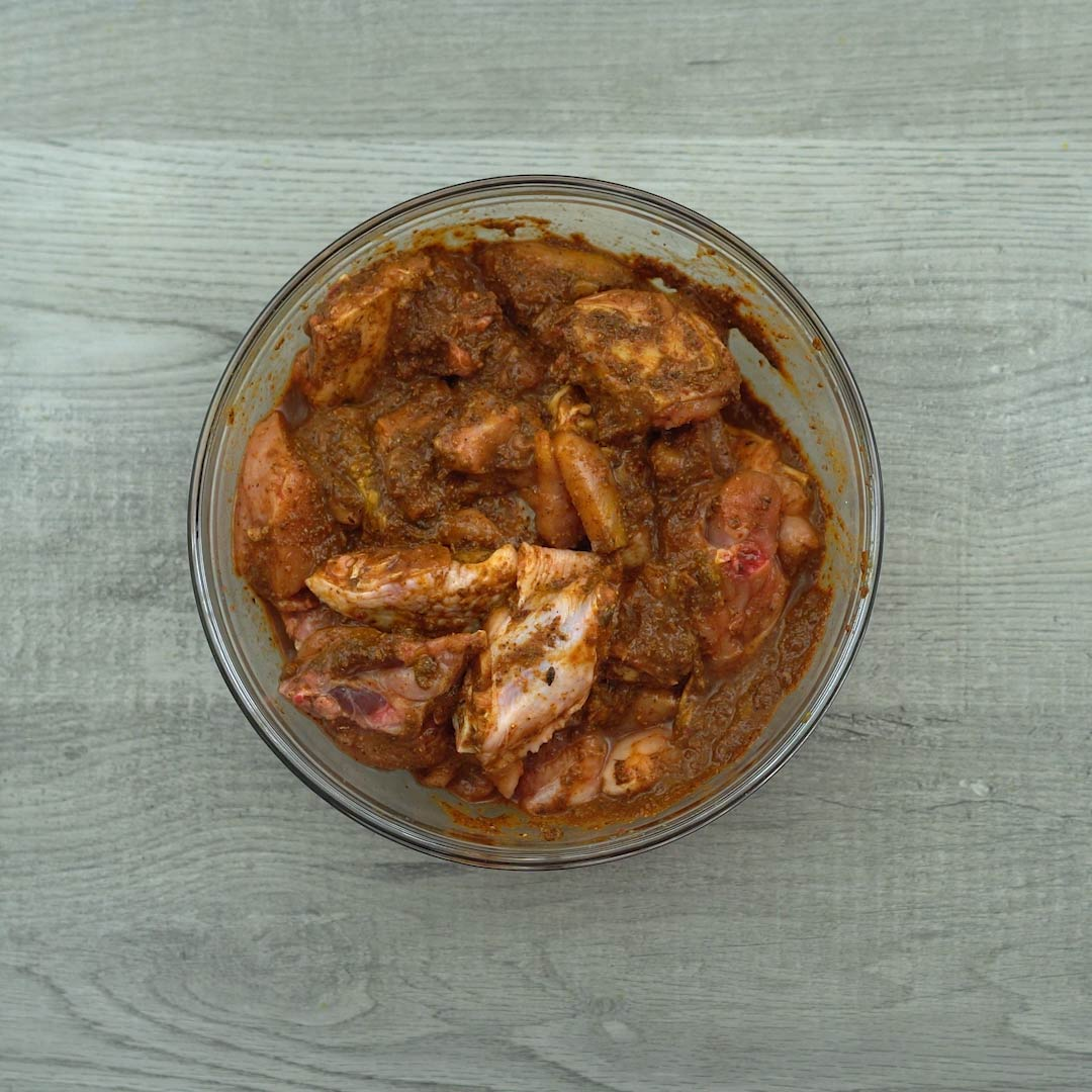 Resting the marinated chicken in a bowl