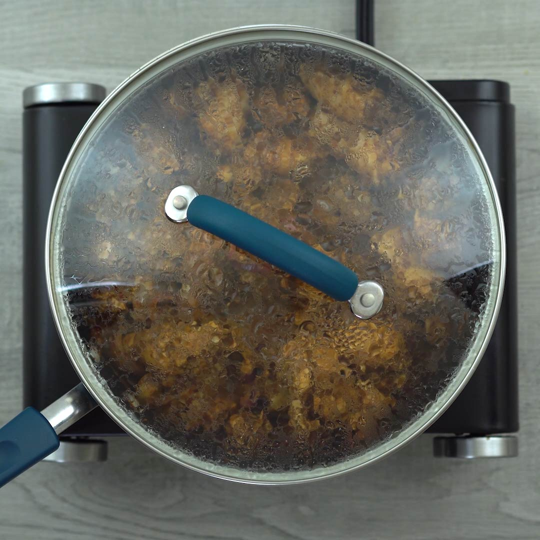 chicken cooking with lid closed