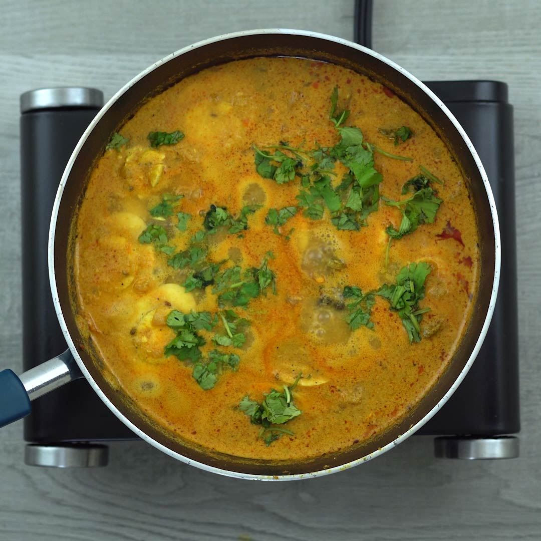 Egg Curry is garnished with coriander leaves