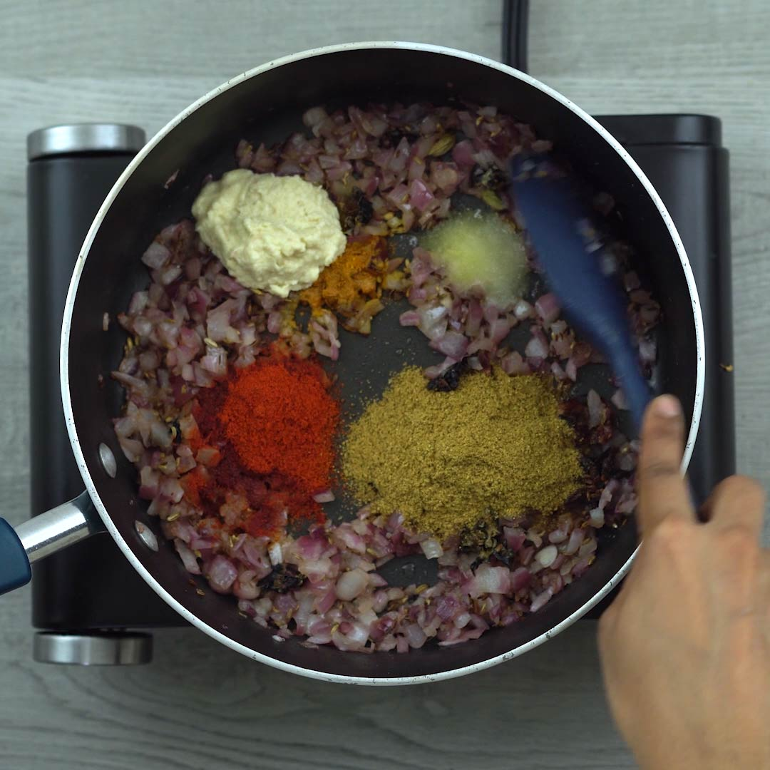 Mixing spice powders and ginger garlic paste