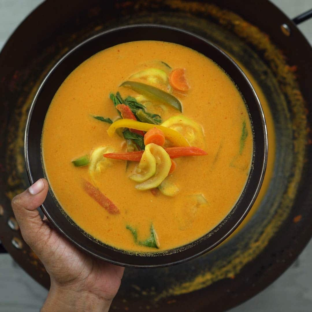 Thai red curry with vegetables in a bowl