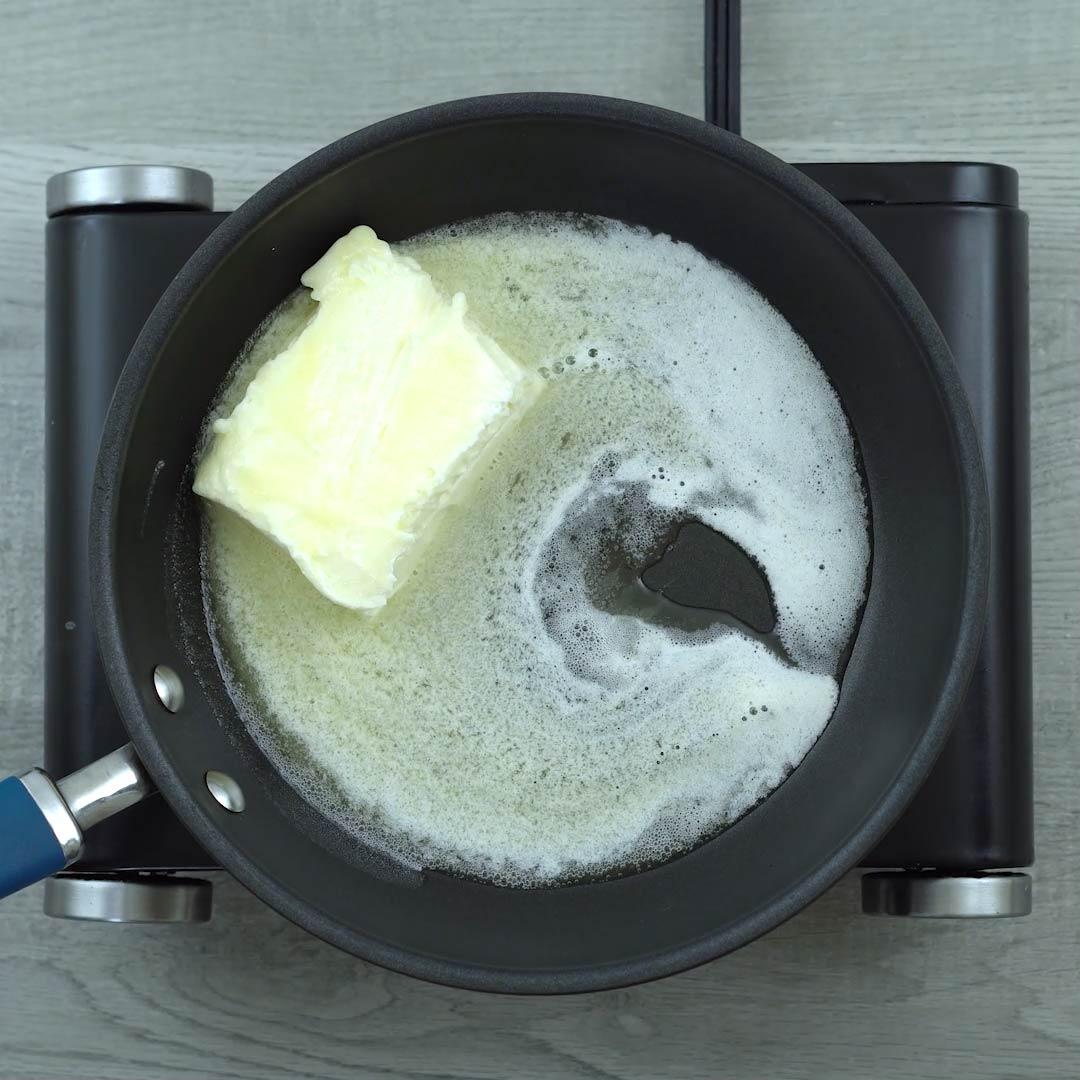 butter is melting in a pan