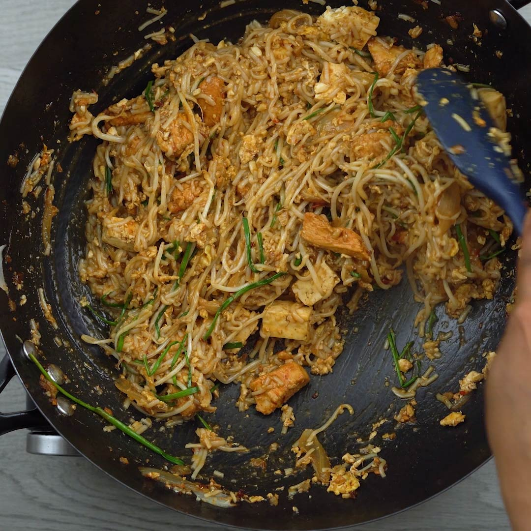Pad Thai noodles being tossed