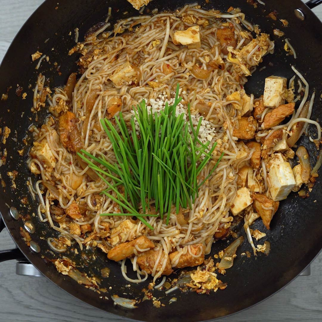 chives and peanuts to the noodles mix
