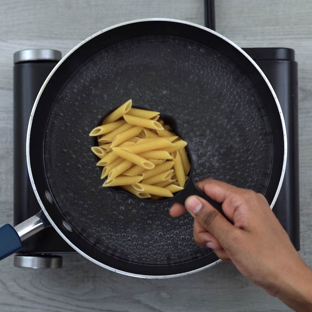 Penne Pasta is adding to boiling water