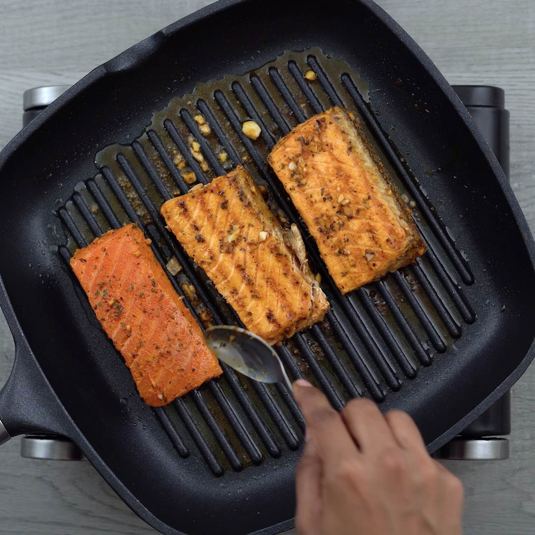 cooking the salmon on both the sides