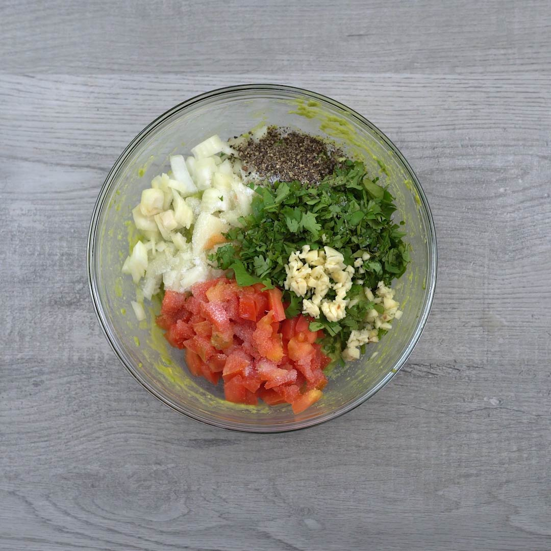 mashed avocado with other ingredients in a bowl