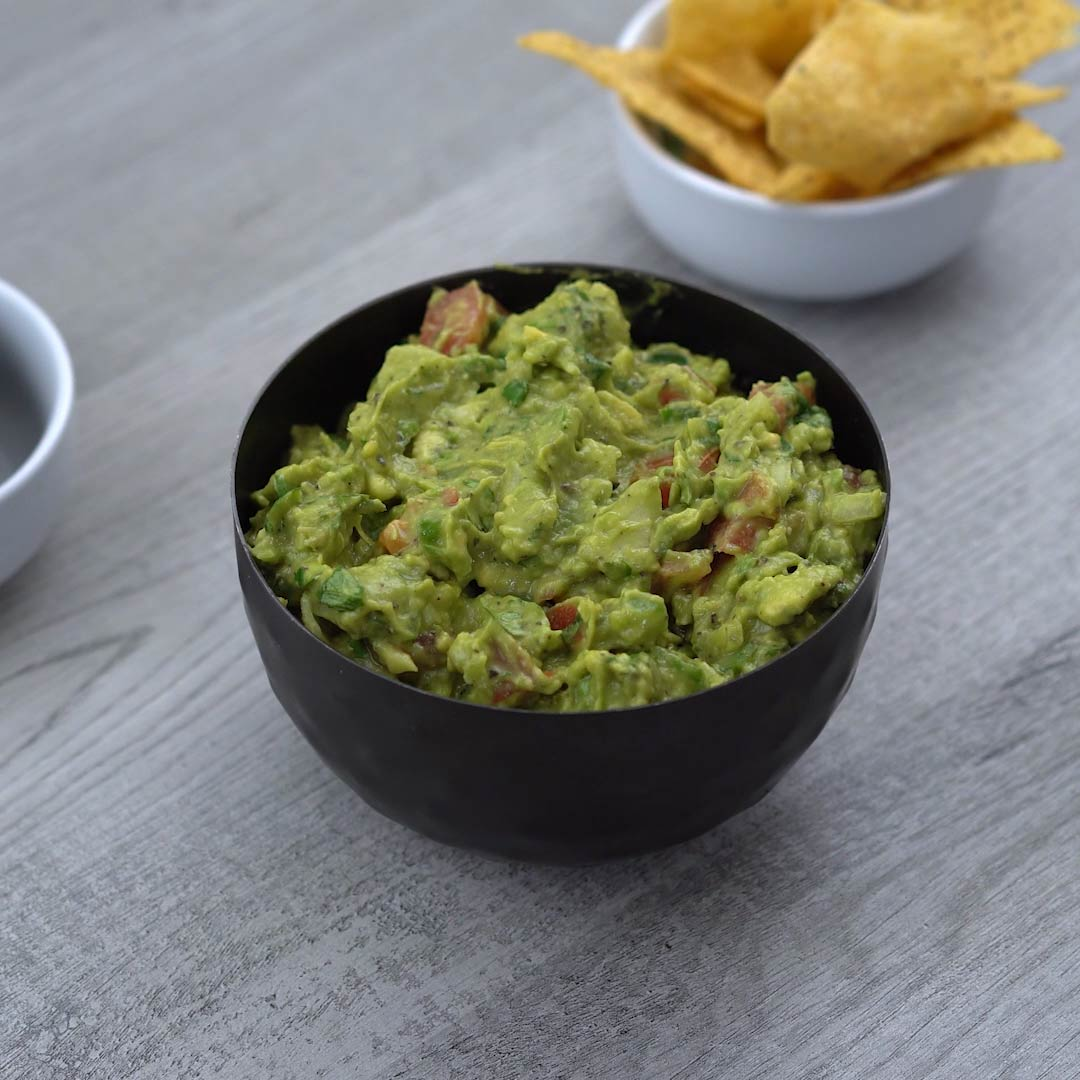 authentic Mexican Guacamole is served with tortilla chips